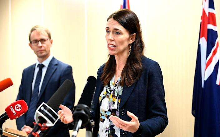 New Zealand Prime Minister Jacinda Arden announces that the quarantine-free travel arrangement with Australia will end tonight for at least eight weeks, due to rising Covid-19 cases in Australia, in Auckland, New Zealand on 23 July 2021 - Hannah Peters/Getty Images