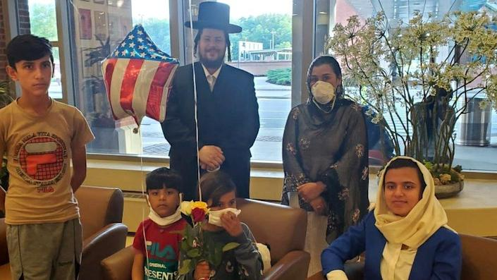 Rabbi Moshe Margaretten with Suneeta (R), and her four children evacuated from Afghanistan