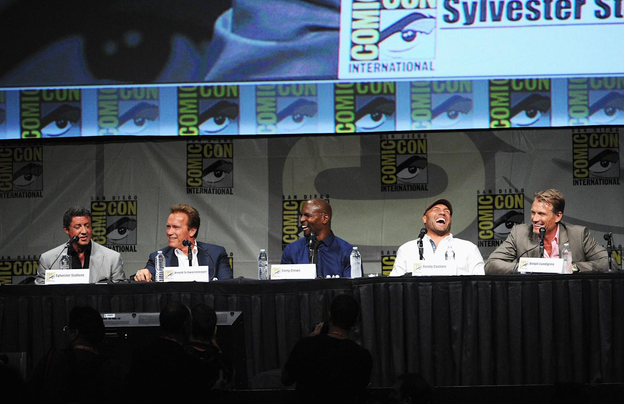 """SAN DIEGO, CA - JULY 12:  (L-R) Actors Sylvester Stallone, Arnold Schwarzenegger, Terry Crews, Randy Couture, and Dolph Lundgren speak at """"The Expendables 2 Real American Heroes"""" Panel during Comic-Con International 2012 at San Diego Convention Center on July 12, 2012 in San Diego, California.  (Photo by Kevin Winter/Getty Images)"""