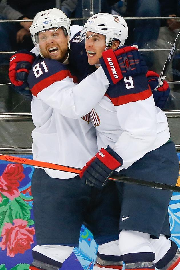 USA forward Zach Parise (9) celebrates his goal with teammate Phil Kessel (81) during the second period of men's quarterfinal hockey game against the Czech Republic in Shayba Arena at the 2014 Winter Olympics, Wednesday, Feb. 19, 2014, in Sochi, Russia. (AP Photo/Petr David Josek)