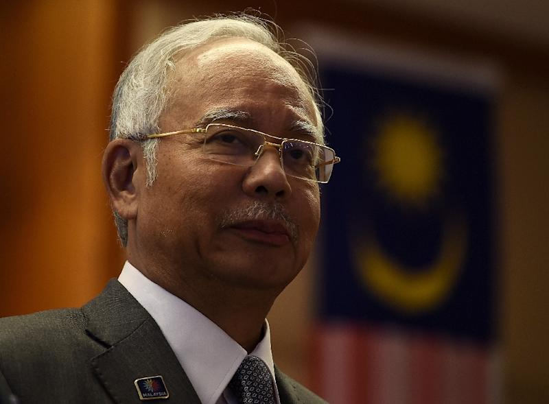 Malaysian Prime Minister Najib Razak denies claims that sums of cash were siphoned off from state-owned development company 1Malaysia Development Berhad (1MDB) to his personal account (AFP Photo/Manan Vatsyayana)