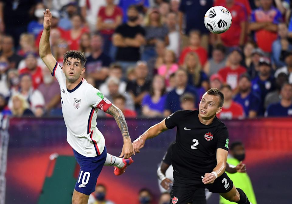 United States midfielder Christian Pulisic (10) heads the ball against Canada during the Concacaf World Cup qualifier at Nissan Stadium.