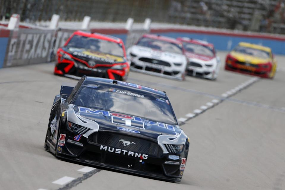 FORT WORTH, TEXAS - JULY 19: Kevin Harvick, driver of the #4 Mobil 1 Ford, leads a pack of cars during the NASCAR Cup Series O\