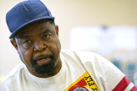 Wilbert Marshall, 71, speaks about his receiving the COVID-19 vaccine, while waiting for a transportation bus at the Rev. S.L.A. Jones Activity Center for the Elderly to take him and other seniors to the Aaron E. Henry Community Health Service Center to receive their vaccinations, Wednesday, April 7, 2021, in Clarksdale, Miss. The Mississippi Department of Human Services is in the initial stages of teaming up with community senior services statewide to help older residents get vaccinated. (AP Photo/Rogelio V. Solis)