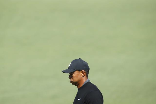 Tiger Woods of the U.S. reacts after missing a birdie putt on the second hole during first round play of the 2018 Masters golf tournament at the Augusta National Golf Club in Augusta, Georgia, U.S., April 5, 2018. REUTERS/Mike Segar