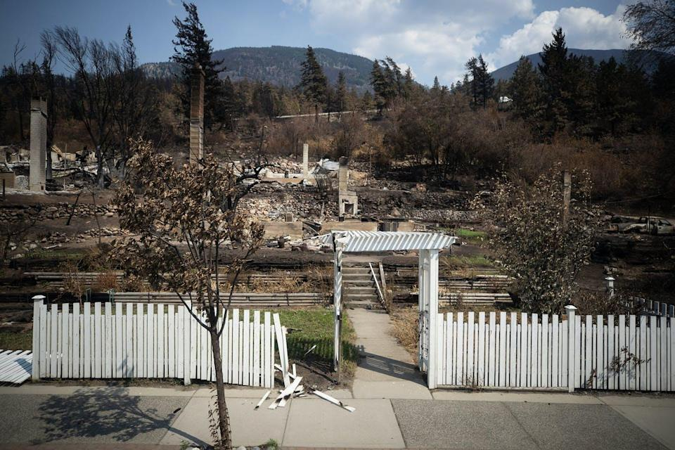 A white picket fence is all that remains after a fire tore through a property