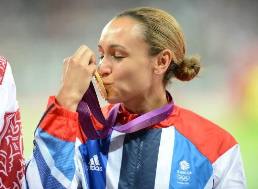 Olympian kissing gold