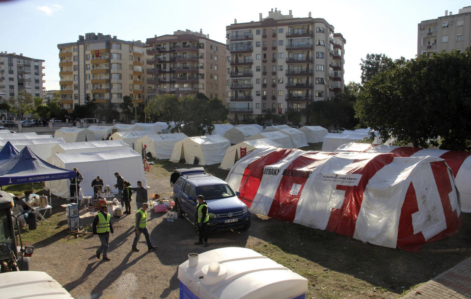 Local residents stay outdoors for fear of strong aftershocks after an earthquake collapsed their houses, in Izmir, Turkey, Sunday, Nov. 1, 2020. The strong earthquake in the Aegean Sea struck Turkey and Greece on Friday. (AP Photo/Ismail Gokmen)