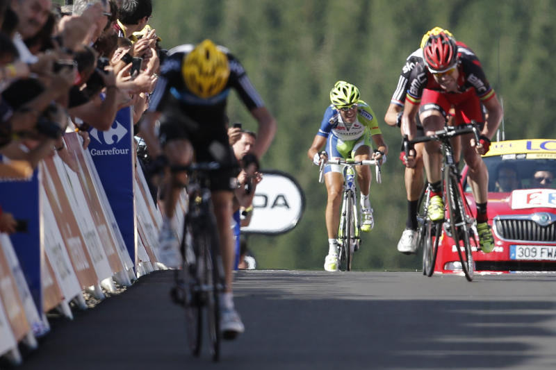 Vicenzo Nibali of Italy, center, finishes fourth, after Christopher Froome of Britain, left, Cadel Evans of Australia, right, and Bradley Wiggings of Britain, behind Evans, during the seventh stage of the Tour de France cycling race over 199 kilometers (123.6 miles) with start in Tomblaine and finish in La Planche des Belles Filles, France, Saturday July 7, 2012. (AP Photo/Laurent Rebours)