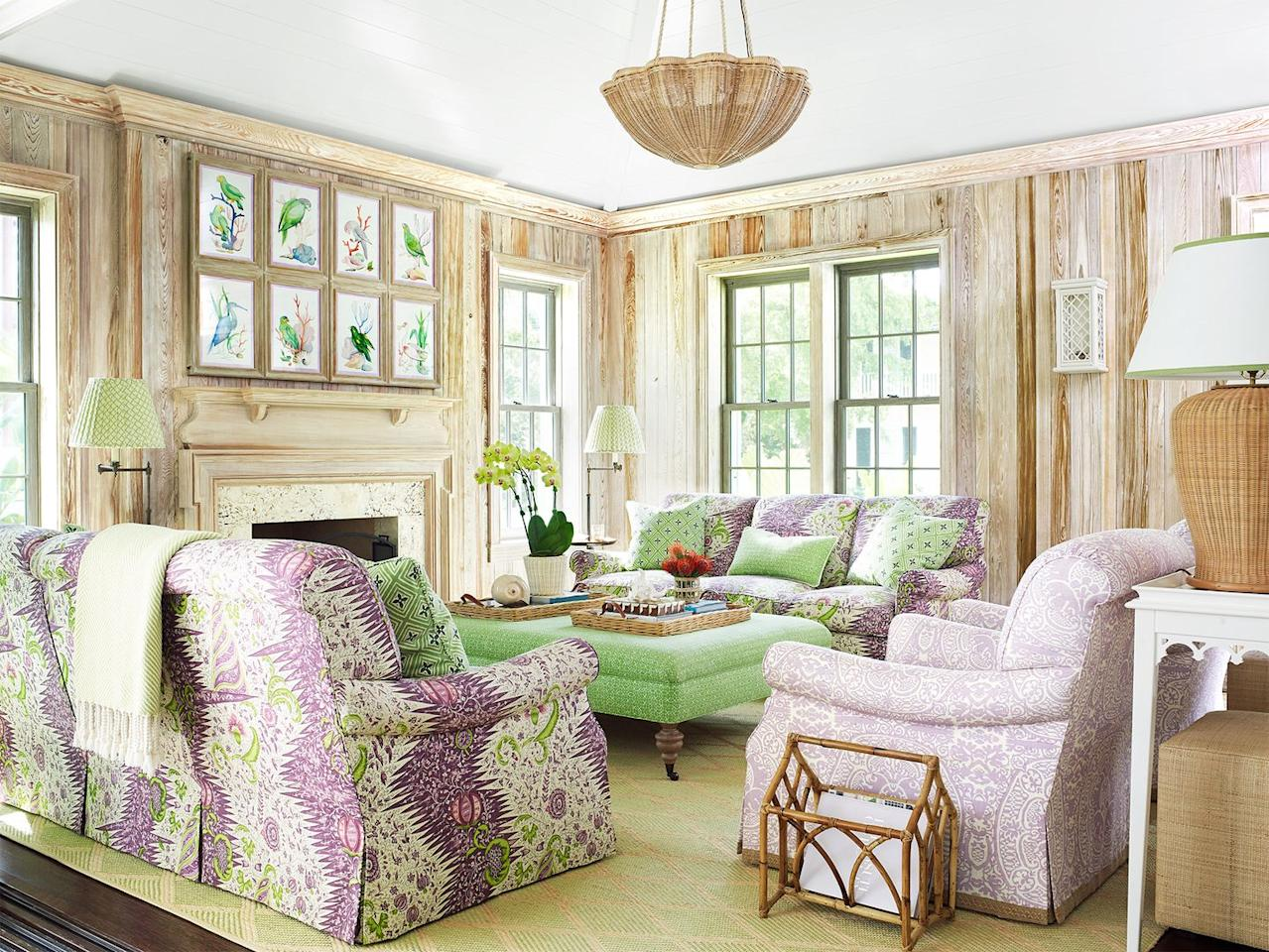 """<p><a href=""""https://www.housebeautiful.com/design-inspiration/house-tours/a29732934/amanda-lindroth-master-cottage/"""" target=""""_blank"""">Amanda Lindroth</a> mixed Quadrille prints in purple and green in a client's Palm Beach living room, proving that opposites do attract—or, at least, opposite sides of the color wheel. </p>"""