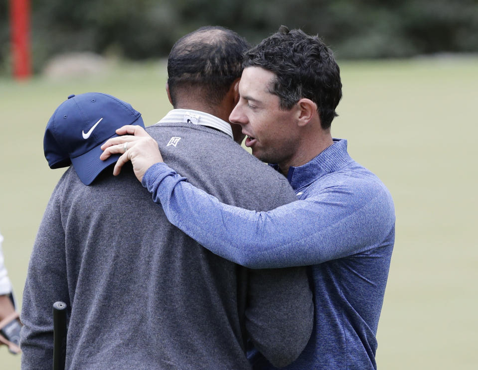 Tiger Woods, left, and Rory McIlroy, right, embrace after their match during fourth round play at the Dell Technologies Match Play Championship golf tournament, Saturday, March 30, 2019, in Austin, Texas. Woods won the match. (AP Photo/Eric Gay)