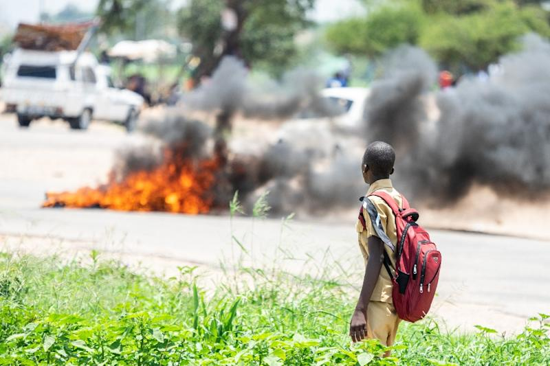 Tens of thousands of people took part in nationwide protests after Mnangagwa more than doubled fuel prices (AFP Photo/ZINYANGE AUNTONY)