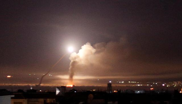 <p>Missile fire is seen from Damascus, Syria May 10, 2018. (Photo: Omar Sanadiki/Reuters) </p>