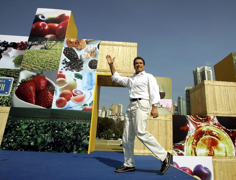 FILE -  In this Nov. 19, 2005 file photo, California Gov. Arnold Schwarzenegger waves while taking the stage to begin a rally to promote California's products in Hong Kong, Saturday Nov. 19, 2005. California has the highest population of Chinese-Americans and is China's top trade partner among U.S. states. Yet it has no trade offices in China, opting to eliminate them in a cost-cutting move a decade ago, and is feeling the pressure from other states that have been far more aggressive in pursuing business from the world's second-largest economy. (AP Photo/Eric Risberg, File)