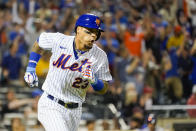 New York Mets' Javier Baez runs the bases after hitting a two-run home run in the sixth inning of the baseball game against the Cincinnati Reds, Saturday, July 31, 2021, in New York. (AP Photo/Mary Altaffer)