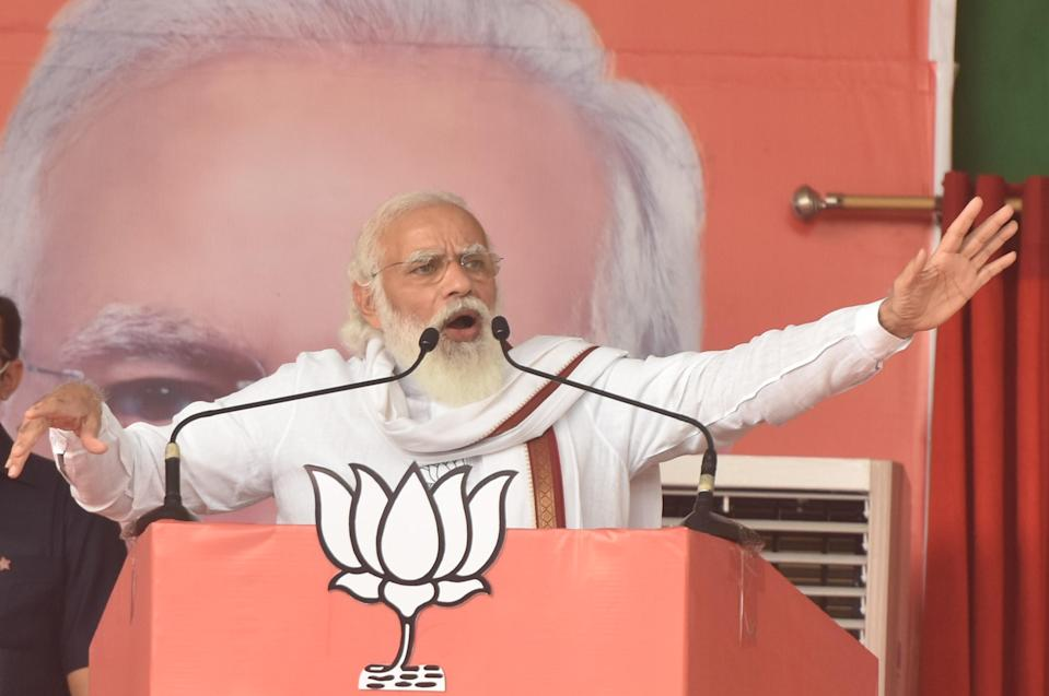 PATNA, INDIA - OCTOBER 28: Prime Minister Narendra Modi addresses the crowd during a campaign rally to garner support for NDA candidates in Bihar Assembly Elections, at Veterinary ground on October 28, 2020 in Patna, India. (Photo by Parwaz Khan/Hindustan Times via Getty Images)