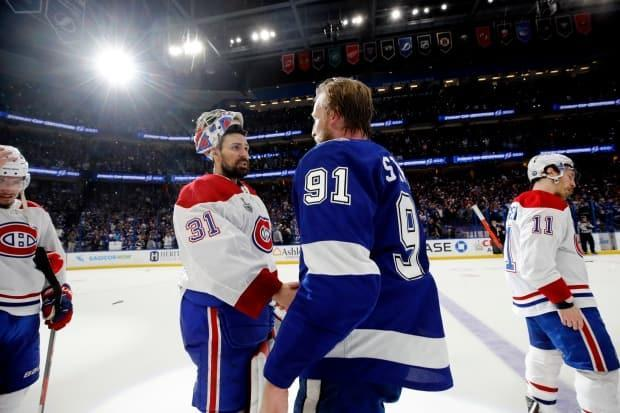 Carey Price, left, shakes hands with the Tampa Bay Lightning's Steven Stamkos after the Montreal Canadiens were defeated in the 2021 Stanley Cup final on Wednesday. (Bruce Bennett/Getty Images - image credit)