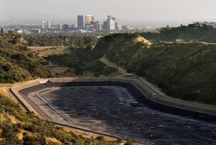 An empty water reservoir is seen in the hills above Los Angeles as a severe drought continues to affect the state of California on April 5, 2015 (AFP Photo/Mark Ralston)