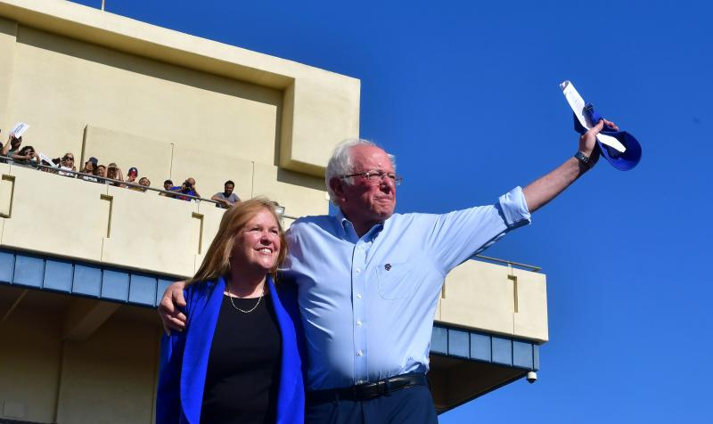 Bernie Sanders and his wife, Jane acknowledge the crowd of supporters during a campaign rally