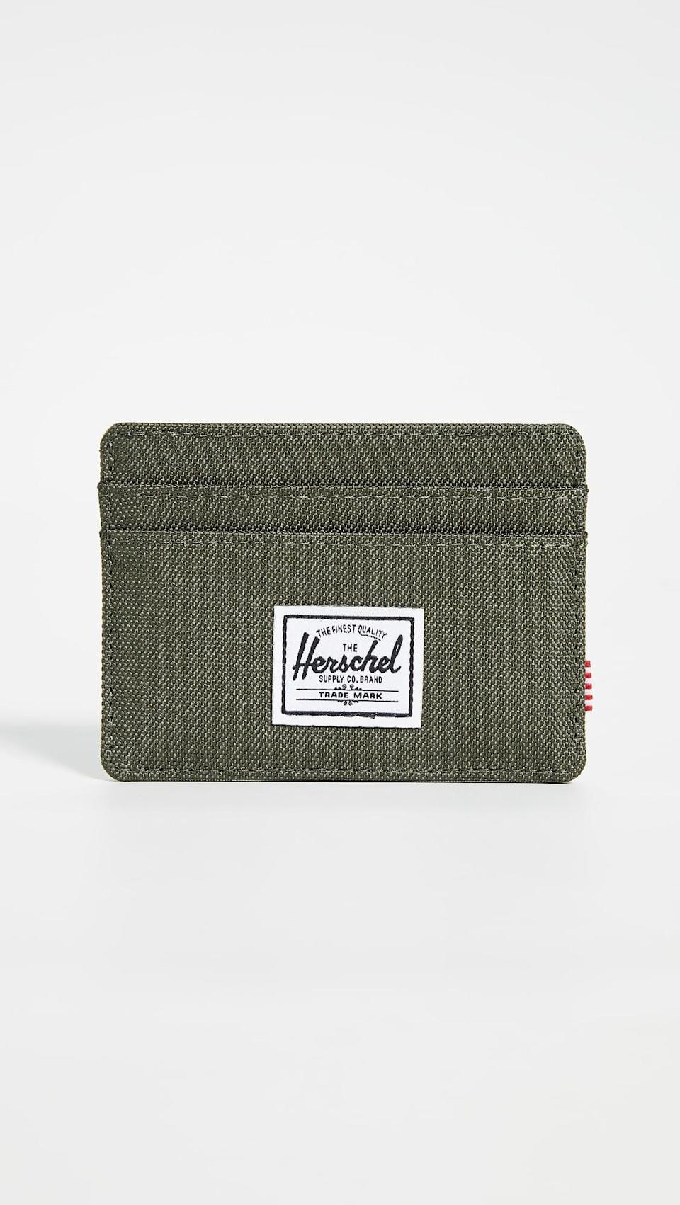 <p>Upgrade his old wallet to this <span>Herschel Supply Co. Charlie Card Case</span> ($22).</p>