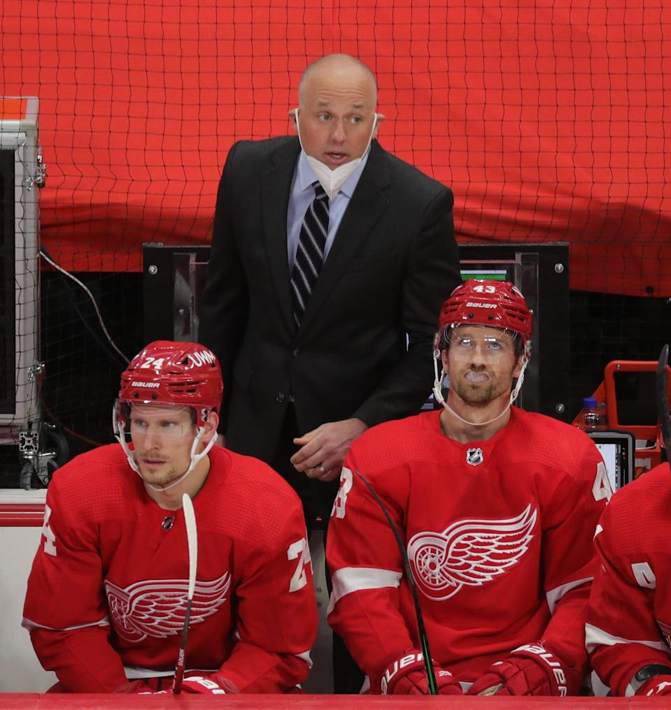 Red Wings head coach Jeff Blashill on the bench in the second period on Thursday, April 15, 2021, at Little Caesars Arena.