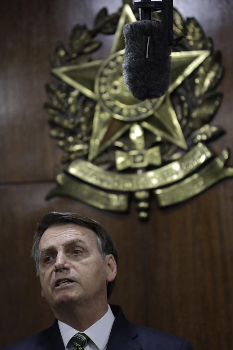 Brazil's President Jair Bolsonaro speaks during the delivery of his government's economic reform proposals to lawmakers at the National Congress headquarters in Brasilia, Brazil, Tuesday, Nov. 5 , 2019. (AP Photo/Eraldo Peres)