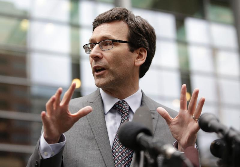 Washington State Attorney General Bob Ferguson address the media following a hearing about US President Donald Trump's travel ban at the US District Court in Seattle, Washington on March 15, 2017 (AFP Photo/Jason Redmond)