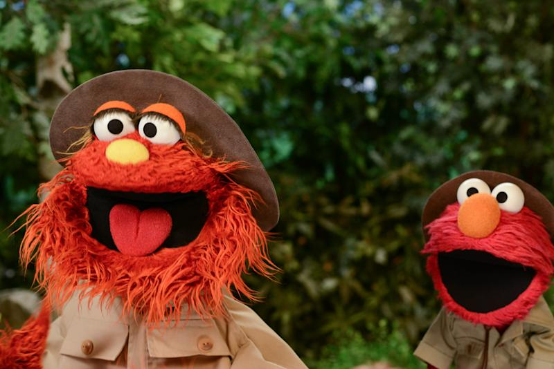 """This undated publicity image released by the Sesame Workshop shows characters Murray, left, and Elmo from the children's program """"Sesame Street,"""" dressed as park rangers for a segment about national parks. A new project has recruited Muppet monsters Elmo and Murray to visit national parks in six short videos that encourage children aged 3 through 5 to experience the great outdoors, wherever it might be, and to apply scientific skills of inquiry to learn about these natural settings. (AP Photo/Sesame Workshop)"""