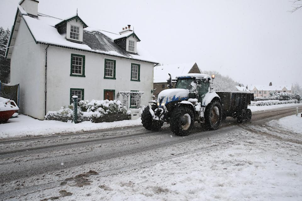 A tractor drives through snow in Braco, near Dunblane in Scotland. (Photo by Andrew Milligan/PA Images via Getty Images)