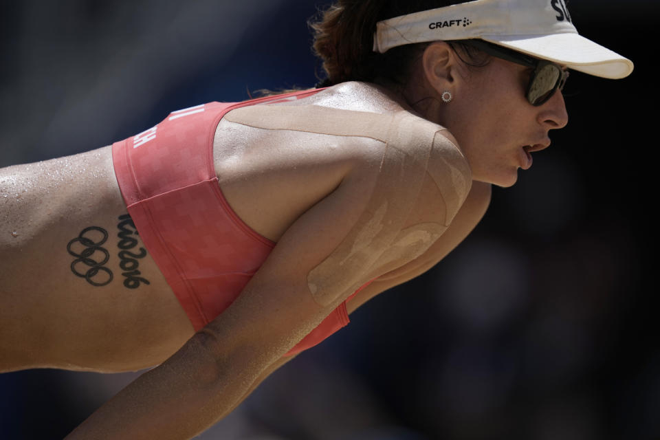 Joana Heidrich, of Switzerland, sports a Rio 2016 Olympic taboo during a women's beach volleyball match against Brazil at the 2020 Summer Olympics, Tuesday, Aug. 3, 2021, in Tokyo, Japan. (AP Photo/Felipe Dana)
