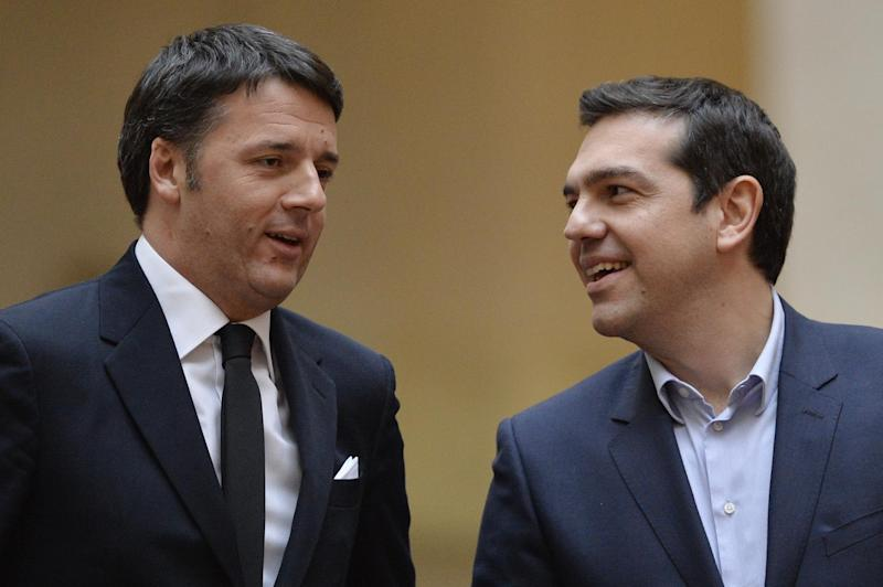 Greek Prime Minister Alexis Tsipras (R) is welcomed by Italian Prime Minister Matteo Renzi before their meeting on February 3, 2015 in Rome