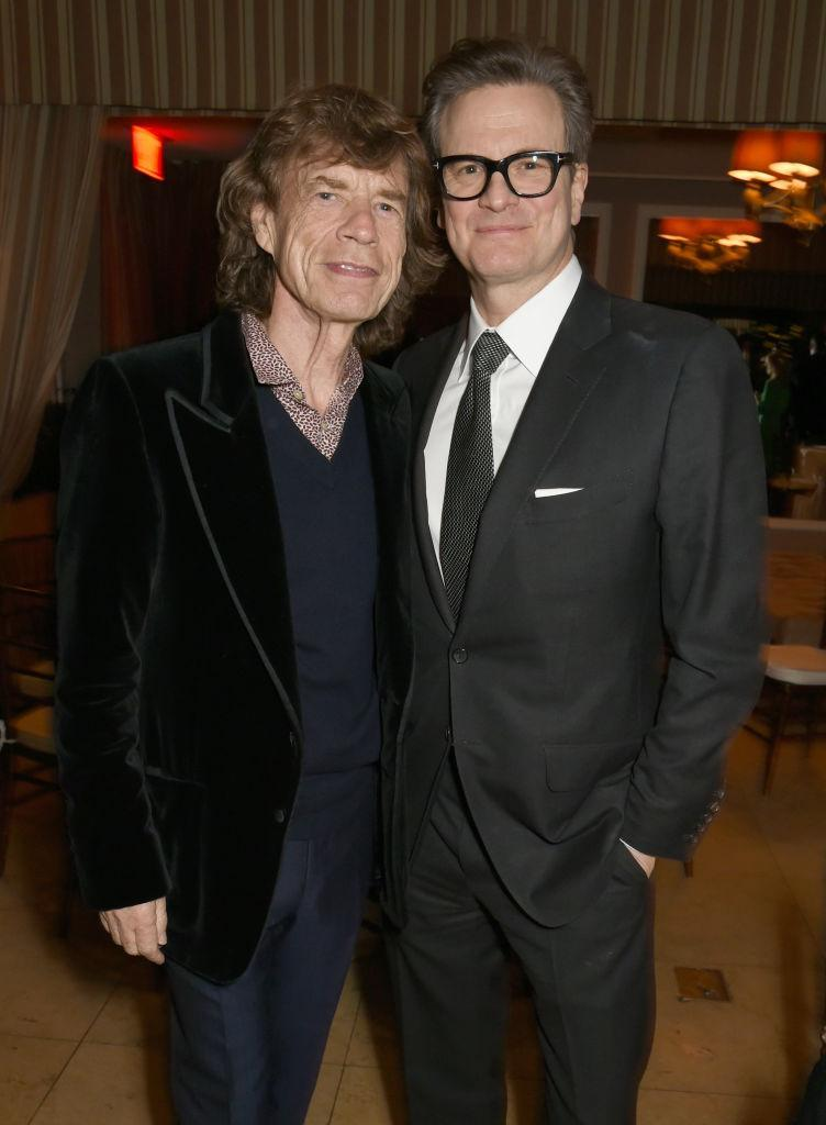 <p>Mick Jagger and Colin Firth at the Green Carpet Challenge party (Photo: Getty Images) </p>