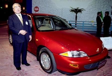 Toyota Motor Corporation's honorary chairman Eiji Toyoda introduces a Toyota Cavalier compact car, m..