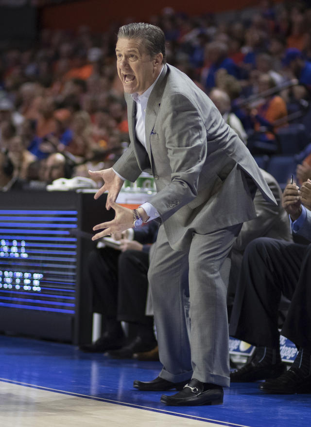 Kentucky head coach John Calipari yells instructions to his team during the first half of an NCAA college basketball game in Gainesville, Fla., Saturday, March 3, 2018. (AP Photo/Ron Irby)