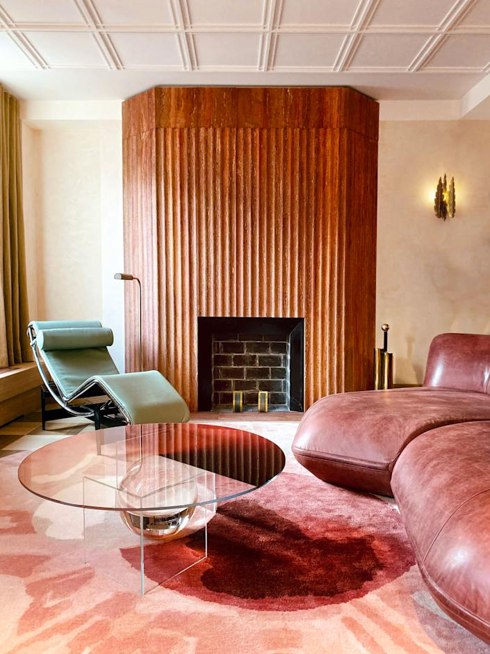 """<div class=""""caption""""> Vintage and contemporary furniture combine and populate the space. Custom designed by Toro & Liautard, the rug from <a href=""""https://www.diurne.com/en/home/"""" rel=""""nofollow noopener"""" target=""""_blank"""" data-ylk=""""slk:Diurne"""" class=""""link rapid-noclick-resp"""">Diurne</a> represents an eye's pupil, which symbolizes human knowledge and brings peace and protection to a home. </div>"""