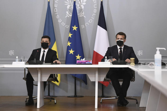 French President Emmanuel Macron, right, and Ukrainian President Volodymyr Zelenskyy hold a press conference following their meeting at the Elysee Palace in Paris Friday April 16, 2021. Ukrainian President Volodymyr Zelenskyy is in Paris for talks with French President Emmanuel Macron and German Chancellor Angela Merkel amid his country's growing tensions with neighboring Russia, which has deployed troops near its border with Ukraine. (Anne-Christine Poujoulat, Pool via AP)