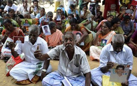 Sri Lankan Tamils hold pictures of family members who disappeared during the war against the LTTE during a protest in Jaffna