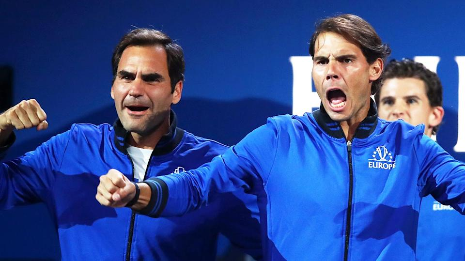 Roger Federer (pictured left) and Rafa Nadal (pictured right) jump up and celebrate.