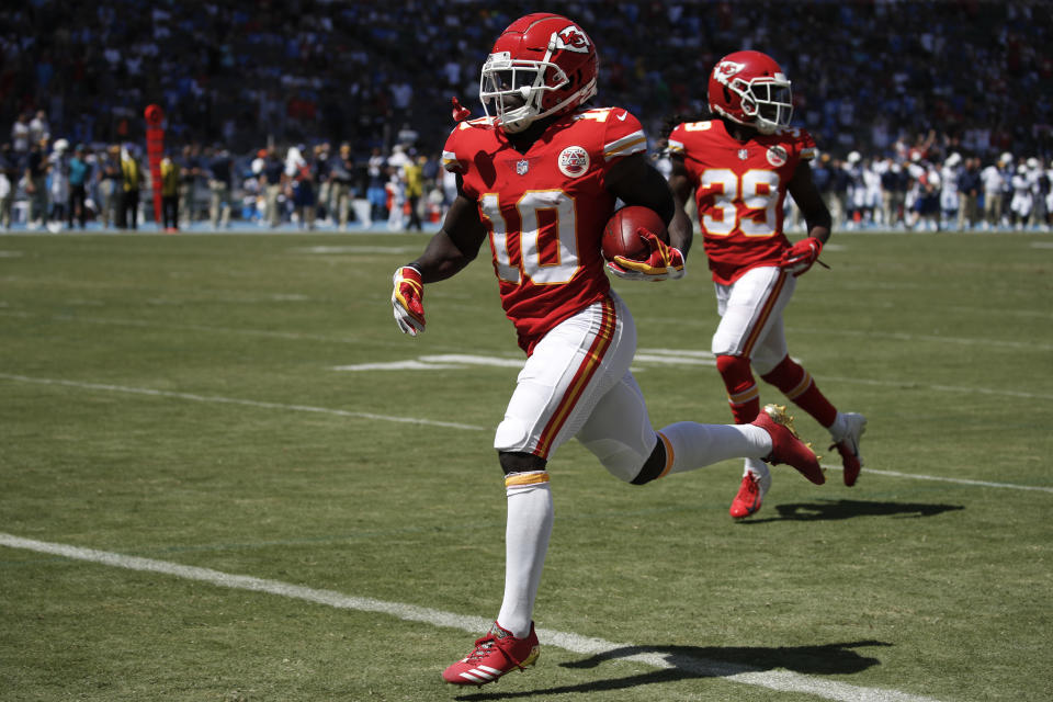 Kansas City Chiefs wide receiver Tyreek Hill (10) scores against the Los Angeles Chargers during the first half of an NFL football game Sunday, Sept. 9, 2018, in Carson, Calif. (AP Photo/Jae C. Hong)