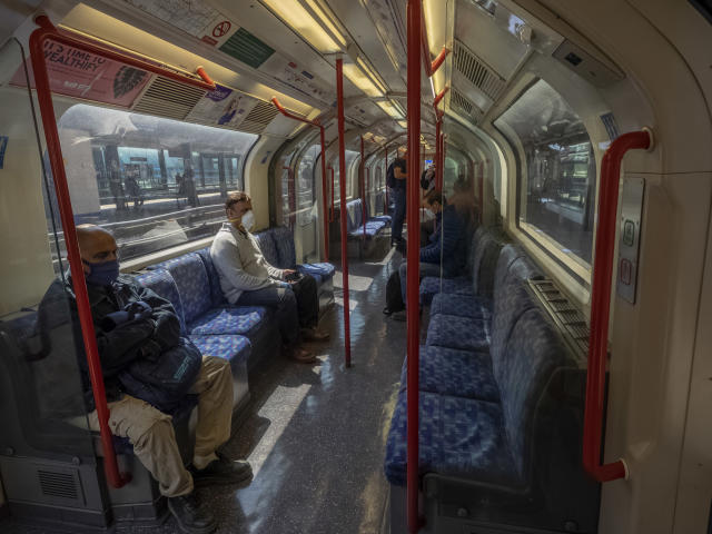 Passengers on Central Line train at Stratford station in London during the Lockdown. (Reuters)