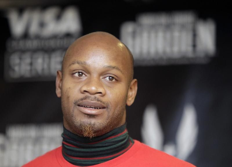 FILe - In this Jan. 26, 2012 file photo, former 100-meter world record holder Asafa Powell listens to reporters' questions during a press conference in New York. Powell has been banned from his sport for 18 months. The 31-year-old sprinter tested positive for the banned stimulant oxilofrone at Jamaica's national trials last June. (AP Photo/Kathy Willens, File)