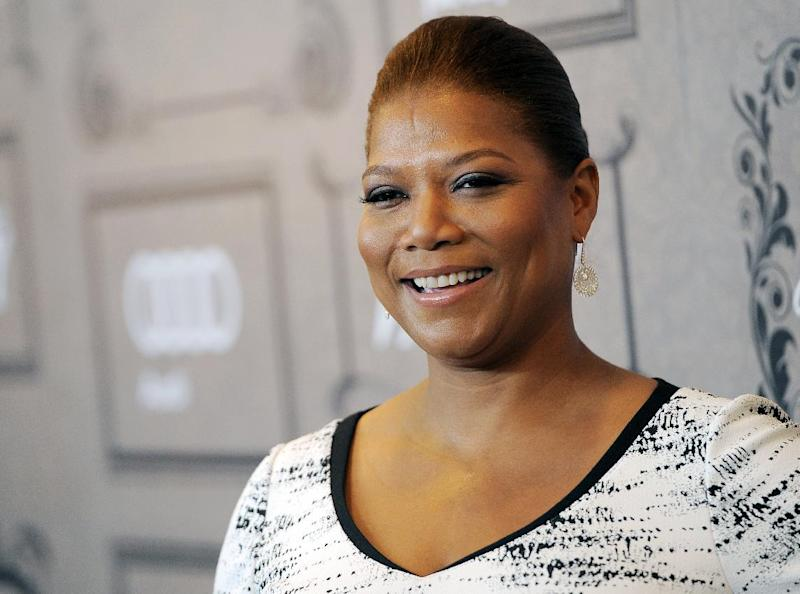 "FILE - This Oct. 5, 2012 file photo shows Queen Latifah at Variety's 4th annual Power of Women event in Beverly Hills, Calif.  Queen Latifah's production company, Flavor Unit Entertainment, has signed a deal with Netflix. The entertainer announced Tuesday, Feb. 5, 2013, that the multiyear deal gives the streaming service first look at titles from her production company. Latifah launched Flavor Unit in New Jersey with Shakim Compere. It's now based in Miami. The company has produced films such as ""Bringing Down the House"" and ""Just Wright,"" both starring Latifah. (Photo by Chris Pizzello/Invision/AP, file)"