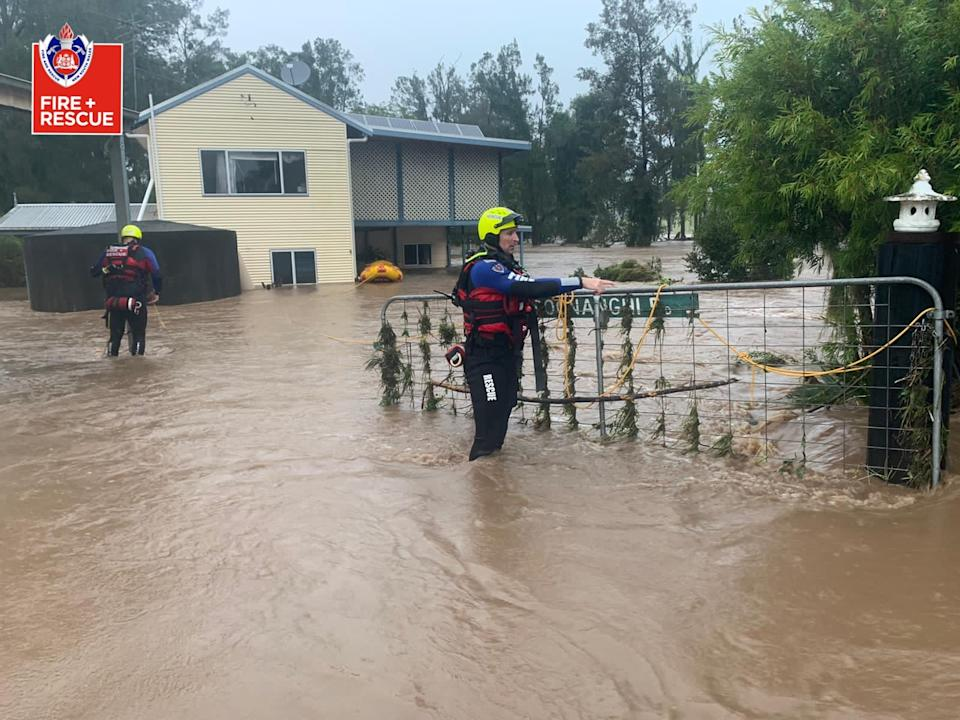 Fire and Rescue NSW crew seen helping local residents in the Mid North Coast of NSW, Friday, March 19,2021. More rain is forecast for the NSW coast and other parts of the state, with flood warnings in place and the premier advising residents to stay home. Source: AAP/Fire and Rescue NSW