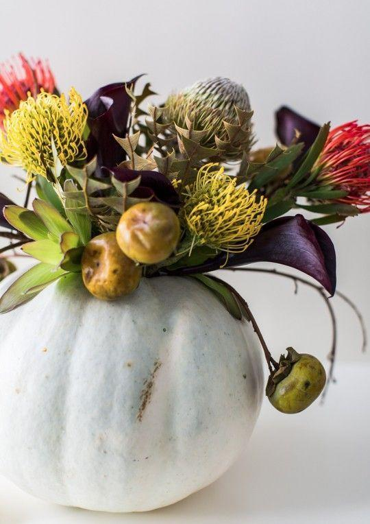 """<p>Bring the colors of autumn into your home with this beautiful centerpiece idea. The pumpkin itself acts as the vase!</p><p><strong>Get the tutorial at <a href=""""https://sugarandcloth.com/diy-halloween-floral-centerpiece/"""" rel=""""nofollow noopener"""" target=""""_blank"""" data-ylk=""""slk:Sugar & Cloth"""" class=""""link rapid-noclick-resp"""">Sugar & Cloth</a>.</strong></p><p><strong><strong><strong><strong><strong><strong><strong><a class=""""link rapid-noclick-resp"""" href=""""https://go.redirectingat.com?id=74968X1596630&url=https%3A%2F%2Fwww.walmart.com%2Fsearch%2F%3Fquery%3Dfaux%2Bflowers&sref=https%3A%2F%2Fwww.thepioneerwoman.com%2Fhome-lifestyle%2Fdecorating-ideas%2Fg36664123%2Fwhite-pumpkin-decor-ideas%2F"""" rel=""""nofollow noopener"""" target=""""_blank"""" data-ylk=""""slk:SHOP FAUX FLOWERS"""">SHOP FAUX FLOWERS</a></strong></strong></strong></strong></strong></strong><br></strong></p>"""