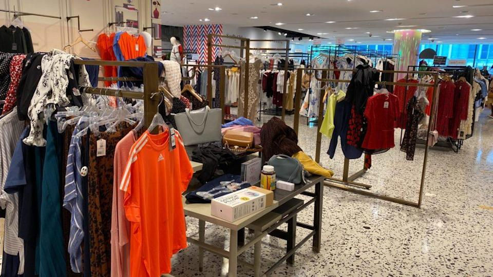 Clothing, some unhung, and other random items thrown everywhere at The Heeren outlet. Photo: Coconuts