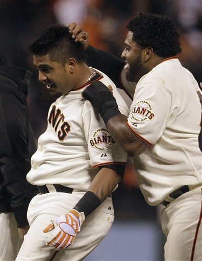San Francisco Giants' Hector Sanchez, left, and Pablo Sandoval celebrate after Sanchez made the game winning hit off Houston Astros' Brett Myers in the 12th inning of a baseball game Saturday, July 14, 2012, in San Francisco. (AP Photo/Ben Margot)