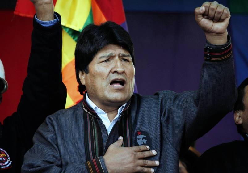"""Bolivian President Evo Morales, singing the national anthem at a May Day march in La Paz, has expelled USAID from his nation, complaining that Washington """"still has a mentality of domination and submission"""" in the region."""