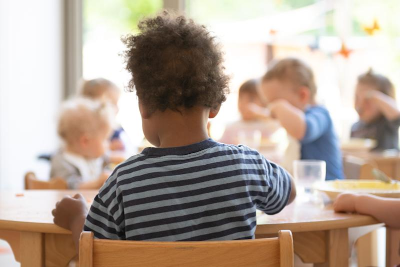 """14 May 2020, Saxony, Dresden: The children of a child crèche sit at a table during lunch as part of the emergency care. (to dpa """"""""Tummy rumbling is part of it"""" - Kitas in Saxony before the new start"""") Photo: Sebastian Kahnert/dpa-Zentralbild/dpa (Photo by Sebastian Kahnert/picture alliance via Getty Images)"""