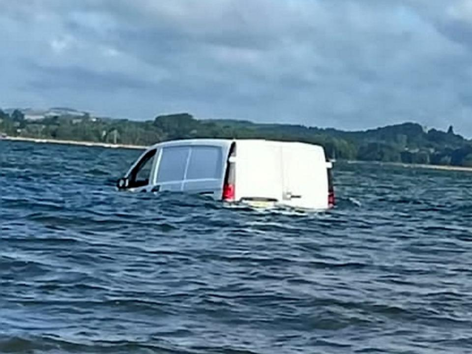 The vehicle was seen floating off Exmouth, Devon. (SWNS)