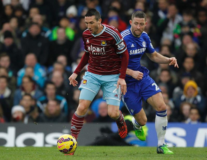 West Ham United's midfielder Morgan Amalfitano (L) during the English Premier League football match in London on December 26, 2014